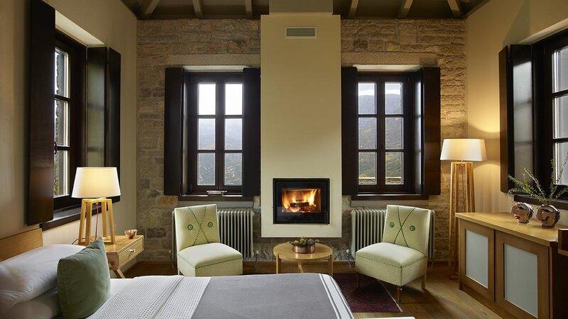 Griekenland-Epirus-Aristi-Mountain-Resort-kamer-met-haardvuur