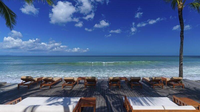 Indonesië-Bali-Seminyak-The-Legian-ligbedden-strand
