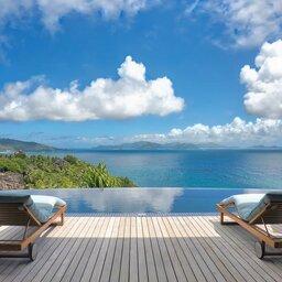 Seychellen-Félicité-Six-Senses-Zil-Payson-zwembad-ligbedden